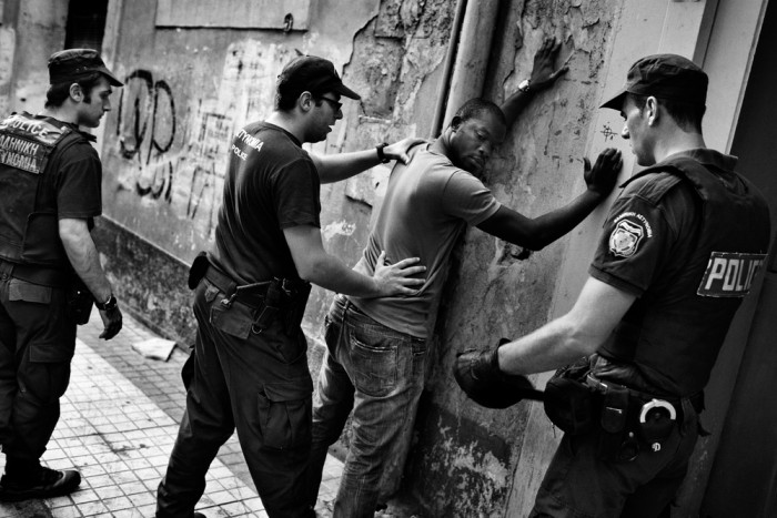 Greek police form the Omonia Police Department round up suspected illegal immigrants in Athens, Greece on August 31, 2012. Greek authorities launched a crackdown called Xenios Dias aimed at detaining and deporting high numbers of illegal immigrants. Photo by Adam Ferguson