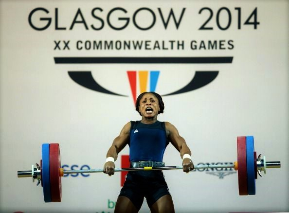 GLASGOW, SCOTLAND - JULY 26: Ndidi Winifred of Nigeria on her way to Silver in the Women's 58kg A Final at Scottish Exhibition And Conference Centre during day three of the Glasgow 2014 Commonwealth Games on July 26, 2014 in Glasgow, United Kingdom. (Photo by Richard Heathcote/Getty Images)