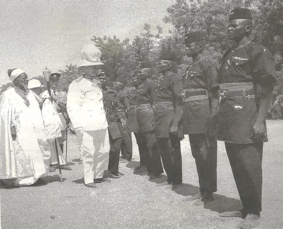 source daily trust_gov. general john macpherson accompanied by Shehu of Borno, Alhaji Umar El Kanemi, inspects a parade by the Borno Native Authority police May 10, 1952