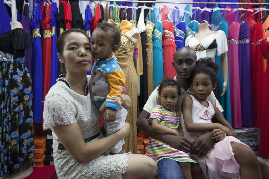 Chinese national Cherry and husband Cellou from Guinea pose for a picture with their children in Guangdong. MAY14 [01JUNE2014 FEATURE 1 POST MAGAZINE]