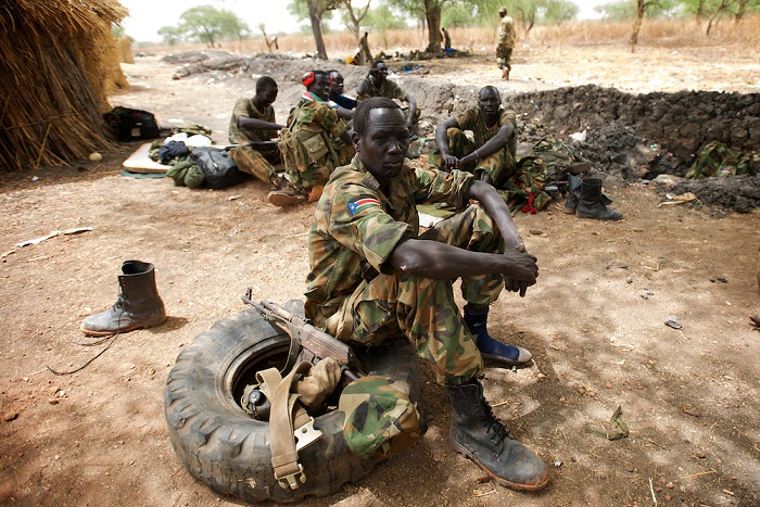 April 24, 2012 - Lalop, South Sudan: A group of SPLA soldiers rest at the newly established military base in the village o Lalop, 50 kilometers north of Bentiu. South Sudan and their northern neighbors, Sudan, have in the past two weeks been involved in heavily clashes over border disputes. Bentiu and neighboring villages have been under constant bombardment by the troops os Karthoum , who established their positions around 10 kilometers into South Sudan's territory. The international community is concerned about the possibility of a full on war between the two countries. (Paulo Nunes dos Santos/Polaris)