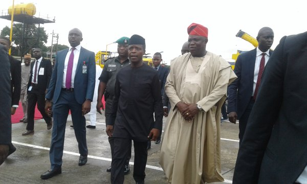 Nigeria's Vice President, Prof. Yemi Osinbajo (l) and Lagos State governor, Akinwunmi Ambode walks through some of the commissioned roads in Lagos State