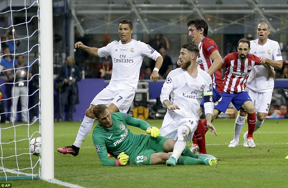 Ramos steers the ball underneath the fallen goalkeeper as Atletico failed to play to their strengths in the first 15 minutes of the encounter