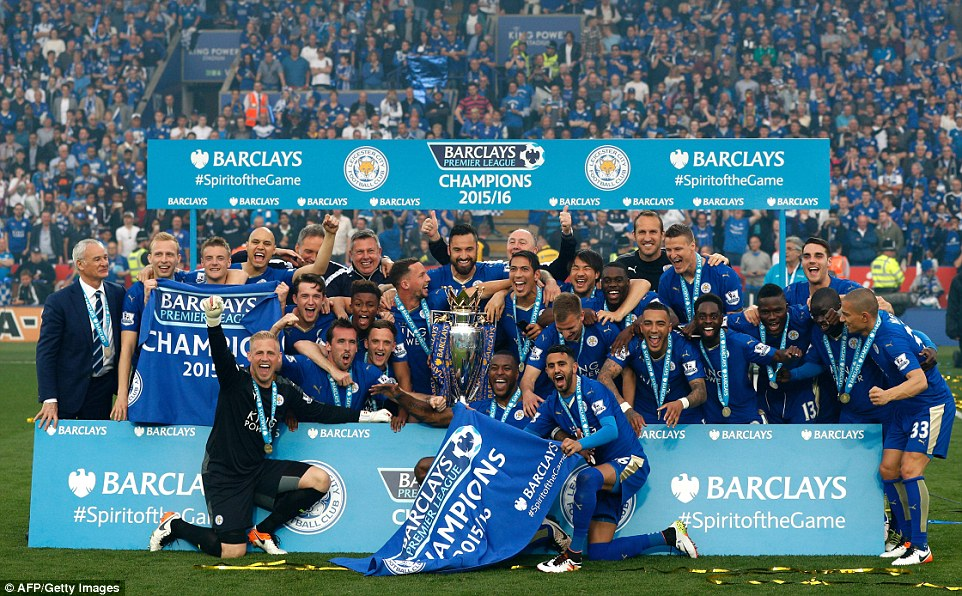 The Premier League title-winning Leicester City players pose for a team photo with their crown as the celebrations begin at the King Power