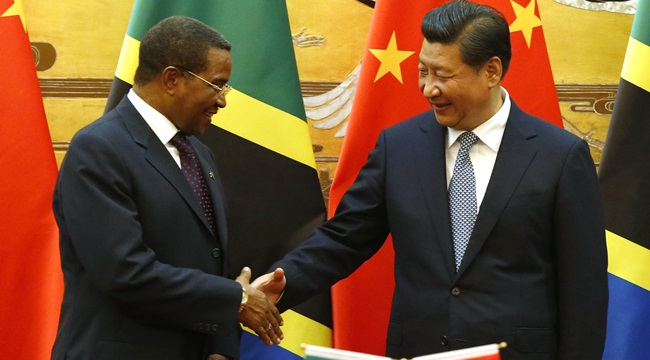 Chinese President Xi Jinping, right, shakes hands with his Tanzanian counterpart Jakaya Kikwete during a signing ceremony at the Great Hall of the People in Beijing, Friday, Oct. 24, 2014. China said it will provide $81 million worth of aid to help fight Ebola in the three West African countries at the heart of the crisis. The foreign ministry says Xi made the announcement when he met Kikwete. (AP Photo/Takaki Yajima, Pool)