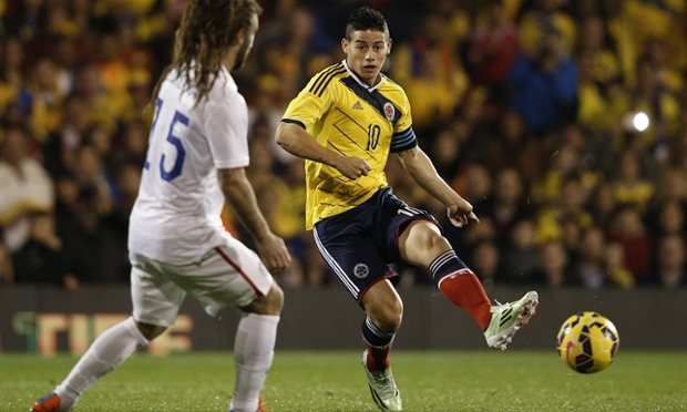 Colombia's midfielder James Rodriguez passes the ball past US midfielder Kyle Becherman Photograph Getty Images