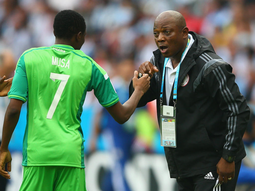 PORTO ALEGRE, BRAZIL - JUNE 25: Ahmed Musa of Nigeria celebrates scoring his team's second goal and his second of the game with head coach Stephen Keshi during the 2014 FIFA World Cup Brazil Group F match between Nigeria and Argentina at Estadio Beira-Rio on June 25, 2014 in Porto Alegre, Brazil. (Photo by Paul Gilham/Getty Images)
