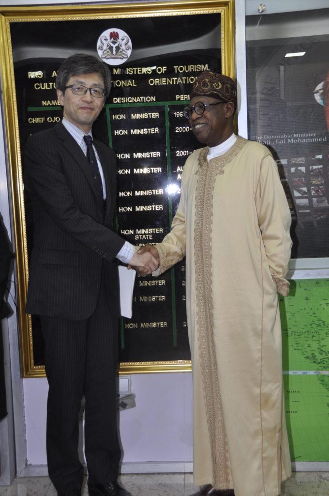 Japanese Ambassador to Nigeria Sadanobu Kasauke in handshake with Nigeria's minister of Information, Lai Mohammed. photo Information ministry