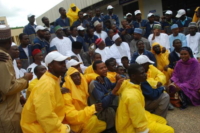 Kano state governor Umar Ganduje in red cap in a photograph with the trainees..photo author provided