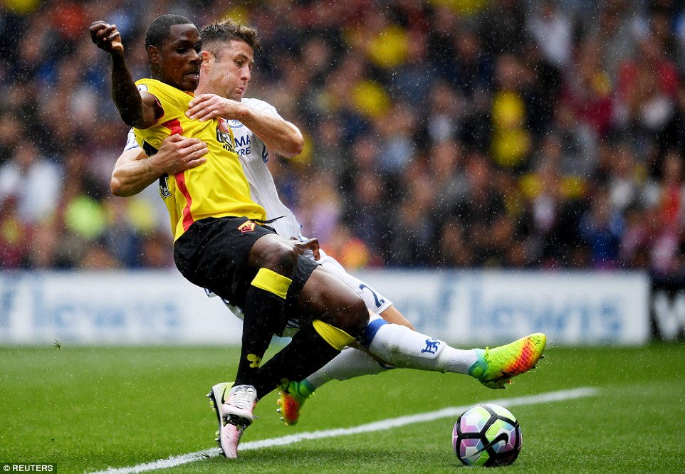 Gary Cahill (right) takes a hands-on approach here in trying to mark Watford striker Odion Ighalo photo credit Reuters