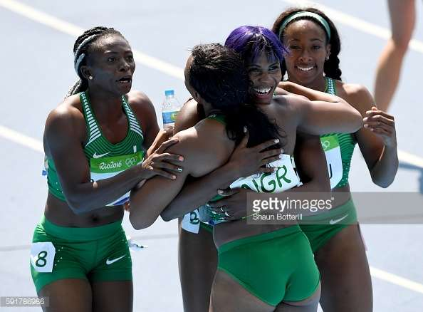 Gloria Asumnu, Blessing Okagbare, Jennifer Madu and Agnes Osazuwa of Nigeria react during round one of the Women's 4 x 100m Relay photo credit by Shaun Botterill of Getty Images
