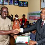 Obaseki receiving his certificate as winner of the election